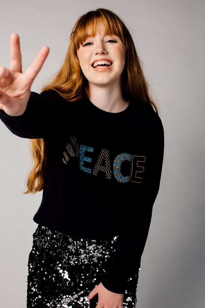 Make a statement in Uzma Bozai's slogan Peace sweatshirt